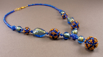 disco ball blue and gold necklace